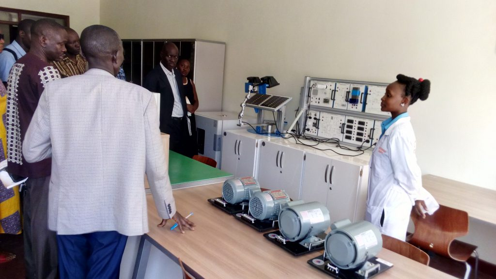 Instructor demonstrates how the Solar Power Machine work to the Visitors in the Electrical Laboratory